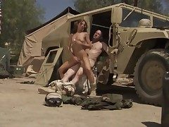 Soldier in uniform is drilling a girl